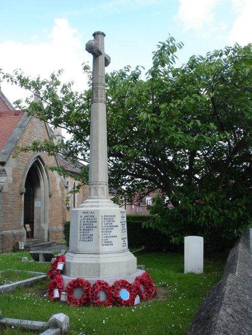 Cenotaph with  the war grave of  Ada Elizabeth Young in the background - near the gate in the original Churchyard