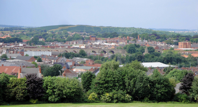 Distant view of Mansfield rooftops and bridge, from a field