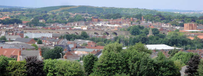 View of Mansfield town centre rooftops, showing railway bridge among the houses