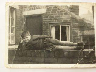 A youthful John Hudson posing on Frank Browns wall,Duke St. | Marlene Townsend.