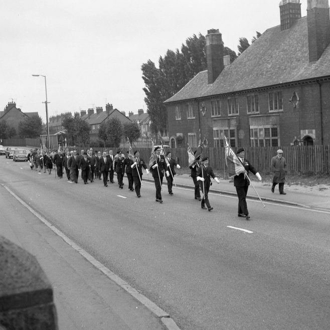 Marching past the Miners Welfare Institute | CHAD 33881
