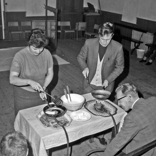 Adults pancake making | CHAD 35724 (Feb 1970)