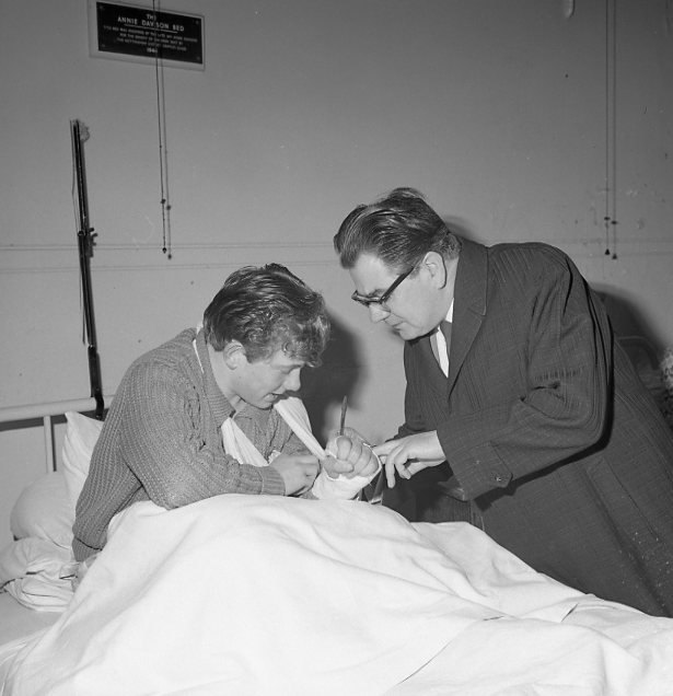 Signing a young patients plaster cast - 1964 | Chad 5658