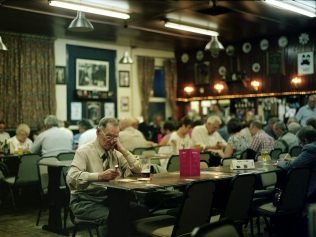 Playing Bingo, alone - Boothy's Working Mens Club, Mansfield | David Severn
