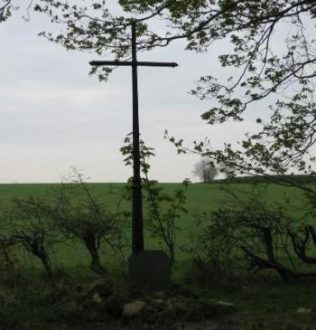 The cross marking the site of St Edwin's Chantry a short distance away from Post B