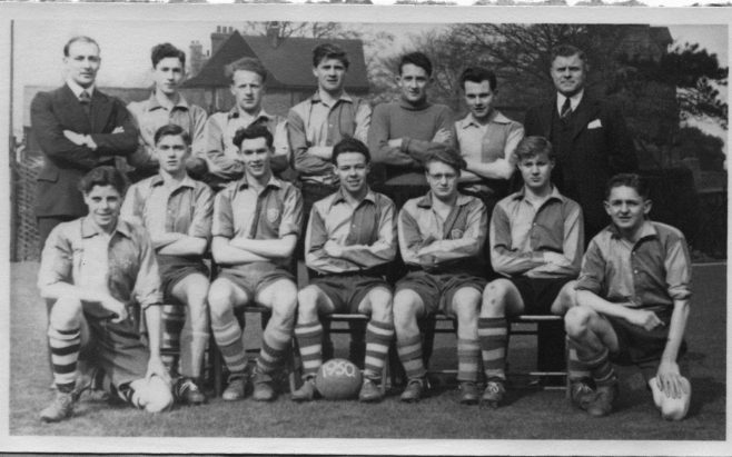 Obviously 1950.  The guy kneeling (front left) is