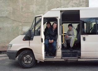 Local teenagers in the community mini bus - Newstead Village | David Severn