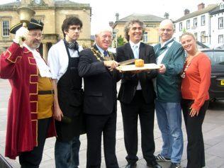 Mayor Tony Egginton cuts the gigantic pie in 2010