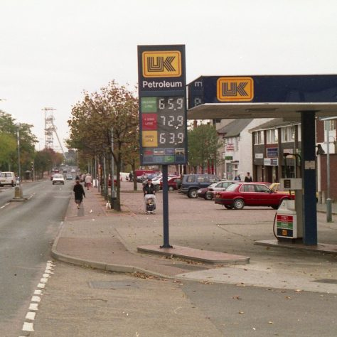 Mansfield Road - note cars parked outside shops & the garage serving petrol. | Malcolm Marples