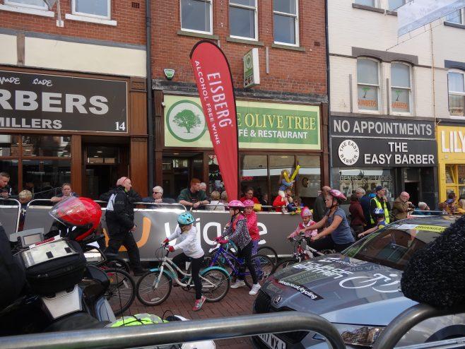 Children cycling up Leeming Street | M & P Marples