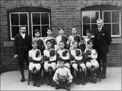 Back row: Mr Townsend ?, Bernard Green, ?, ?, ? Mr Rudge.   Middle row ?, ?, ?, ?, ?.   Front row Cis Stevens | Private collectiom