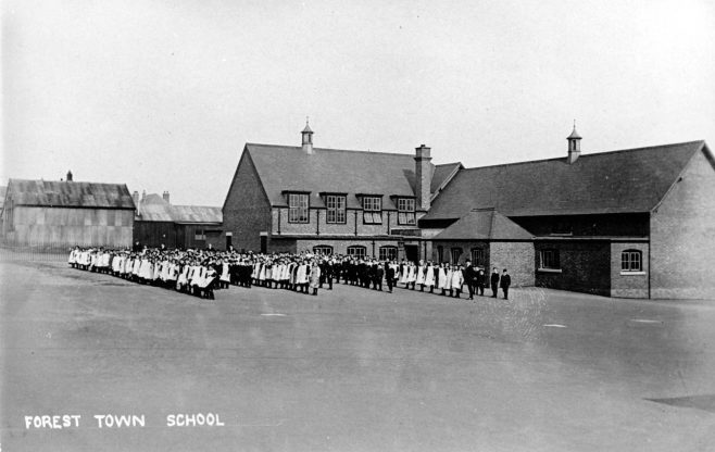 Forest Town School showing the new brick building and two earlier corrugated iron ones in the background. The first school was opened in 1906 | P Marples Collection