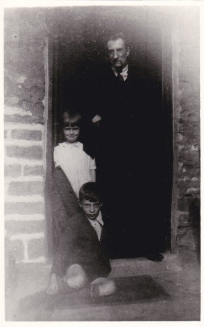 George William Cox with his two youngest children Rennie and George in the door of 45 Blackgate Yard, Woodhouse, 1940 | Glenn Sutcliffe