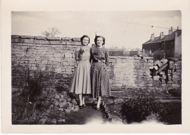 Rennie Cox, born 1934 and her sister Margaret born 1934, in the back garden of 45 Blackgate Yard. | Glenn Sutcliffe