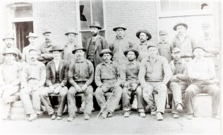 Ed Fisher, the miner, middle front with stick | private family collection