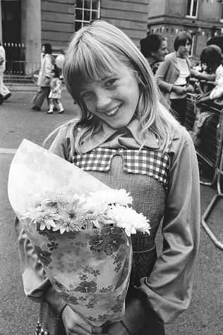 Shelley and the bunch of flowers that her Nana brought her to give to the Queen | Mansfield Chad