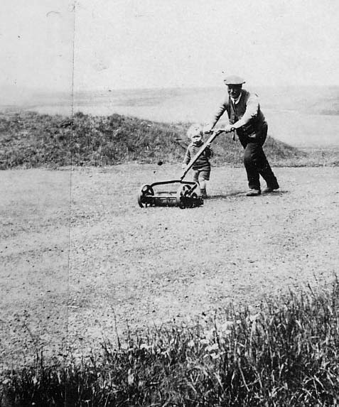George Vamplew & son Bob mowing the green in front of the Golf House | Private Collection