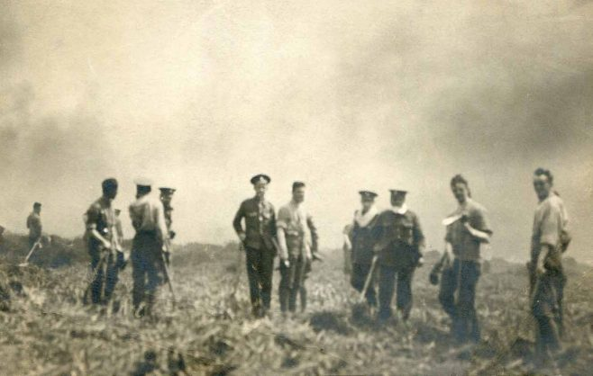 Soldiers and burning heather