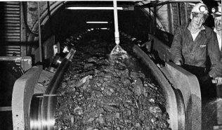 Trunk conveyor in pit bottom